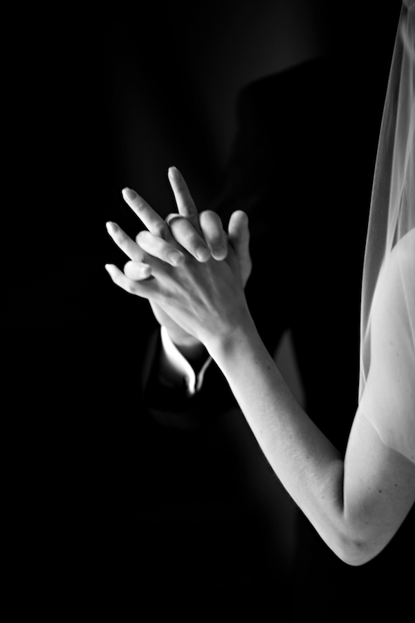 couple-holding-hands-romantic-black-and-white-wedding-photo-by-jason-and-gina